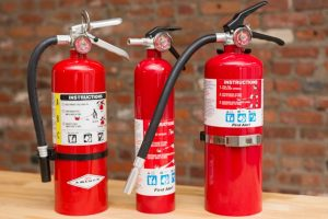 Display of 3 well maintained Fire Extinguishers